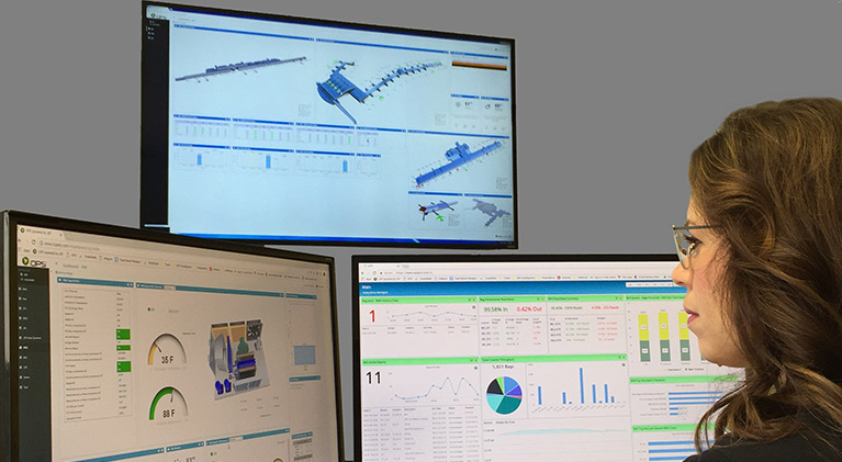 Ground support operator monitoring airport operations using JBT iOPS technology on computer monitors